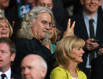 Billy Connolly gestures from the stand