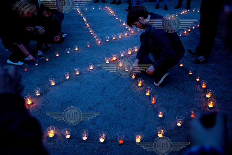 LGBT activists light candles on international HIV Vaccine Awareness Day. /Felix Features (MANDATORY CREDIT   photo: Mads Nissen/Panos Pictures /Felix Features)