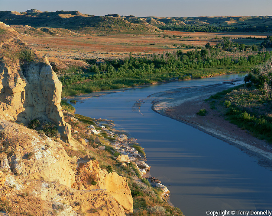 Theodore Roosevelt National Park, ND:  Evening light on badland hills and bend in the Little Missouri River from the Wind Canyon Overlook