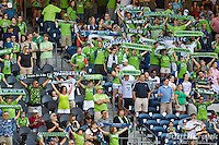 Seattle Sounders FC fans cheer as the Sounders enter the field in a match against Columbus Crew at CenturyLink Field in Seattle, Washington.
