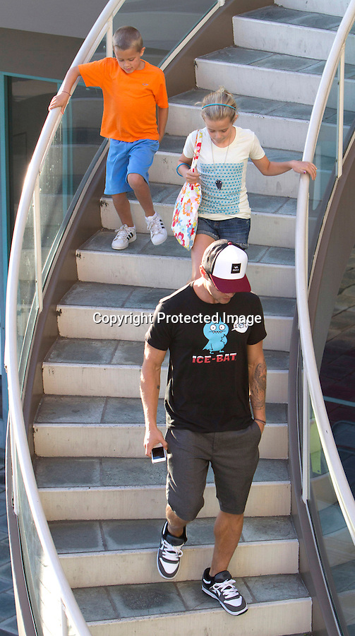 """July 9th 2011..Ryan Phillippe had lunch at a sushi restaurant in Los Angeles with his two kids Eva & Deacon. Ryan was wearing a funny t-shirt that read """"I ice U""""  ICE-BAT  with a little blue bat on it....AbilityFilms@yahoo.com.805-427-3519.www.AbilityFilms.com"""