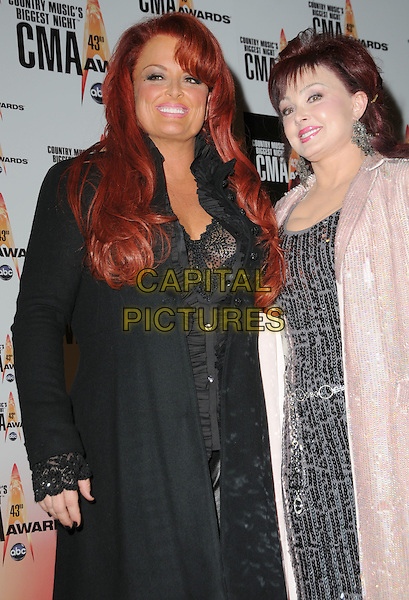 WYNONNA JUDD & NAOMI JUDD of The Judds.Attending the 43rd Annual CMA Awards held at the Sommet Center, Nashville, Tennessee, USA, 11th November 2008..pressroom press room country music .half length  family mother mum mom daughter black coat lace sleeve shirt silver sequined sequin dress  .CAP/ADM/GS.©George Shepherd/AdMedia/Capital Pictures.