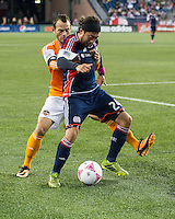 Houston Dynamo forward Brad Davis (11) and New England Revolution midfielder Lee Nguyen (24) battle for the ball at the Houston goal line.  The New England Revolution played to a 1-1 draw against the Houston Dynamo during a Major League Soccer (MLS) match at Gillette Stadium in Foxborough, MA on September 28, 2013.
