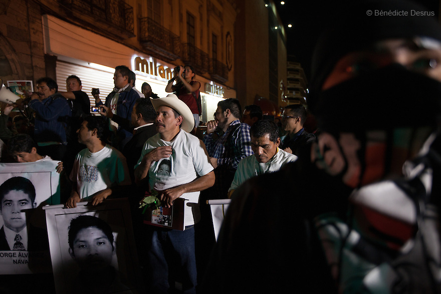 Parents and relatives of the missing students address people to inform about the situation in Guerrero State during a march in protest for the disappearance of 43 students from Ayotzinapa's teacher training college, in Guadalajara, Jalisco, Mexico on November 18, 2014. The parents of the 43 missing students still do not believe the official line that the young men are all dead, and with classmates, social organizations and human rights defenders, they started on Thursday a national caravan. They split up into three different caravans, branching out to share information face to face with supporters in other cities and rally nationwide support. The three groups will meet in Mexico City on Thursday 20 for a general strike and massive marches to demand justice and fight against corrupted government and organized crime. Criticism of the government has intensified in Mexico, and many are demanding that the search for the 43 missing students continue until there is concrete evidence to the contrary. (Photo by Bénédicte Desrus)