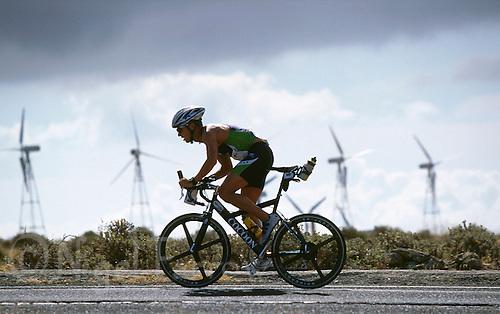 25 MAY 2000 - MIRADOR DEL HARIA, LANZAROTE, CANARY ISLANDS - Ralf Lautenbacher climbs a hill during Ironman Lanzarote '00. (PHOTO (C) NIGEL FARROW)