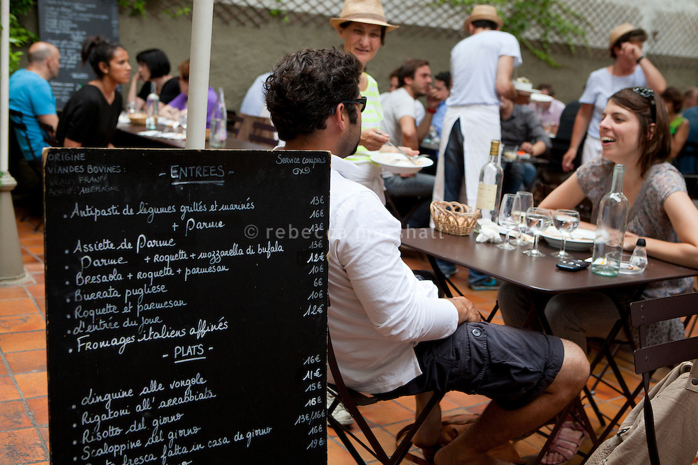 Diners in the garden of La Cantinetta restaurant, Cours Julien, Marseille 17 June 2011