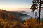 Idaho, North, Kootenai County, Coeur d'Alene. Sunrise over the fog filled valleys of the Coeur d'Alene District of the Idaho Panhandle National Forest in autumn.