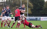 Mark Bright (Captain) of London Scottish is tackled during the Greene King IPA Championship match between London Scottish Football Club and Jersey at Richmond Athletic Ground, Richmond, United Kingdom on 7 November 2015. Photo by Andy Rowland.