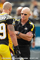 September 11, 2010; Hamilton, ON, CAN; Hamilton Tiger-Cats special teams coordinator Dave Easley speaks with linebacker Agustin Barrenechea (39). CFL football: Montreal Alouettes vs. Hamilton Tiger-Cats at Ivor Wynne Stadium. The Alouettes defeated the Tiger-Cats 27-6. Mandatory Credit: Ron Scheffler. Copyright (c) 2010 Ron Scheffler.