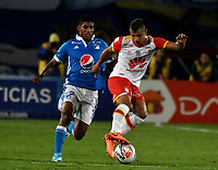 BOGOTA - COLOMBIA - 16 – 07 - 2017: Harold Mosquera (Der.) jugador de Millonarios disputa el balón con Juan Daniel Roa (Izq.) jugador de El Independiente Santa Fe, durante partido de la fecha 2 entre Millonarios y el Independiente Santa Fe, por la Liga Aguila II-2017, jugado en el estadio Nemesio Camacho El Campin de la ciudad de Bogota. / Harold Mosquera (R) player of Millonarios vies for the ball with Juan Daniel Roa (L) player of Independiente Santa Fe, during a match of the date 2nd between Millonarios and Independiente Santa Fe, for the Liga Aguila II-2017 played at the Nemesio Camacho El Campin Stadium in Bogota city, Photo: VizzorImage / Luis Ramirez / Staff.