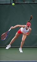 STANFORD, CA - January 26, 2011: Nicole Gibbs of Stanford women's tennis serves during her match against UC Davis' Megan Heneghan. Gibbs won 6-0, 6-2.