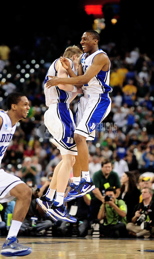 Mar. 28, 2010; Houston, TX, USA; Duke Blue Devils forward (12) Kyle Singler celebrates with guard (2) Nolan Smith following the game against the Baylor Bears during the finals of the south regional in the 2010 NCAA mens basketball tournament at Reliant Stadium.  Duke defeated Baylor 78-71. Mandatory Credit: Mark J. Rebilas-