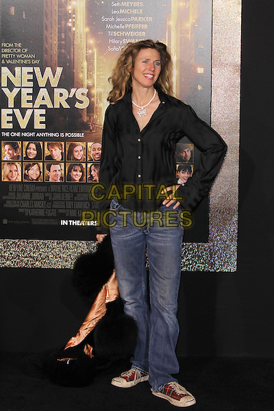 """Sophie B. Hawkins.The World Premiere of """"New Year's Eve' held at The Grauman's Chinese Theatre in Hollywood, California, USA..December 5th, 2011.full length jeans denim side black shirt hand on hip.CAP/CEL .©CelPh/Capital Pictures."""
