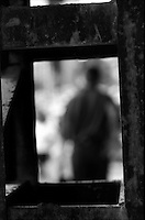 Silhouette of person framed by metal