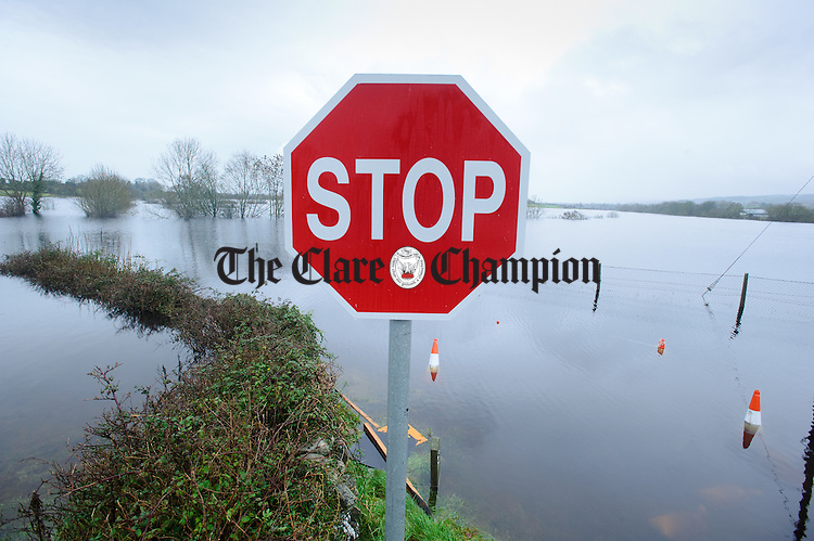 A stop sign escapes the flood waters on the road outside the Coleman family farm in the Loughinwada area near Peterswell in South Galway. Photograph by John Kelly.