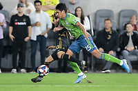LOS ANGELES, CA - OCTOBER 29: Xavier Arreaga #27 of the Seattle Sounders FC defends against Carlos Vela #10 of Los Angeles FC during a game between Seattle Sounders FC and Los Angeles FC at Banc of California Stadium on October 29, 2019 in Los Angeles, California.