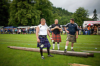 Men wearing kilts prepare for the World Championships for tossing the caber at the Inveraray Highland Games, held at Inveraray Castle in Argyll.