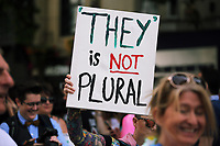 A They is Not Plural placard held up as thousands of people take part in this year's Pride Parade in the centre of Cardiff, Wales, UK. Sayurday 26 August 2017