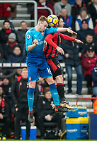 Rob Holding of Arsenal & Adam Smith of AFC Bournemouth during the Premier League match between Bournemouth and Arsenal at the Goldsands Stadium, Bournemouth, England on 14 January 2018. Photo by Andy Rowland.