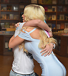"""CORAL GABLES, FL - APRIL 10: Gigi Gorgeous huging a fan after a Q&A and book signing to Promotes Her New Book """"He Said, She Said: Lessons, Stories, and Mistakes from My Transgender Journey"""" at Books and Books on April 10, 2019 in Coral Gables, Florida. ( Photo by Johnny Louis / jlnphotography.com )"""