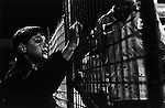 Boy watching the game through a fence at the Holgate end, Boro 3 Tottenham 0, April 20th 1993. Photo by Paul Thompson