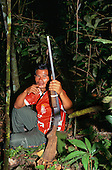 Amazon, Brazil. Bernadine Wapixana in the forest with his shotgun.