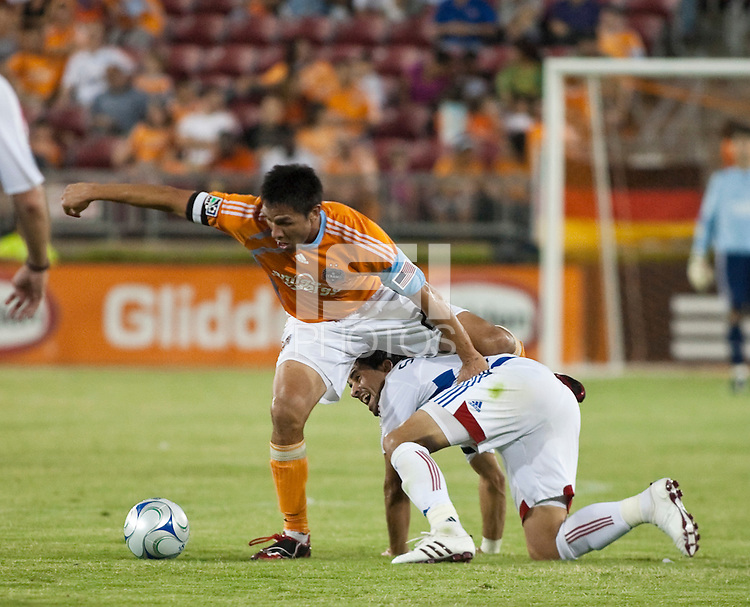 Houston Dynamo forward Brian Ching (25) and FC Dallas midfielder Marcelo Saragosa (5) collide.  Houston Dynamo defeated FC Dallas 1-0 at Robertson Stadium in Houston, TX on May 9, 2009
