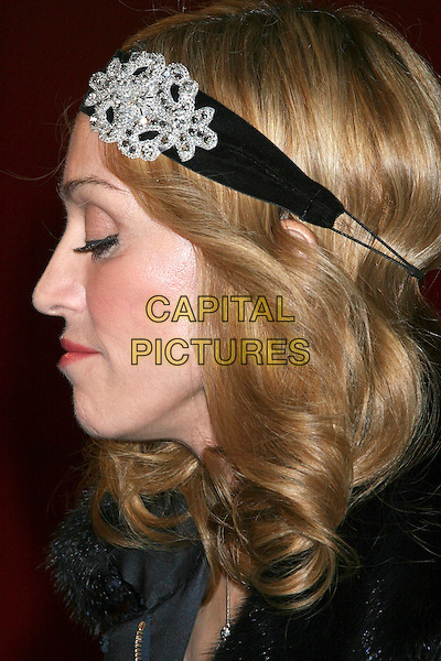 """MADONNA.Premiere """"I'm Going To Tell You A Secret"""" at the Loews Lincoln Center, New York City..STUART PRICE.October 18th, 2005.Ref: IW.headhsot portrait black diamond brooch clasp alice band headband head band profile eyes closed.www.capitalpictures.com.sales@capitalpictures.com.©Capital Pictures"""