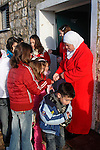 Eid al Adha holiday in the Circassian (Muslim) village Rehaniya in the Upper Galilee, Israel. Circassian women following the tradition of giving coins to the children, 2005<br />
