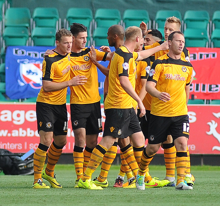 Newport County's Andrew Hughes (second left) celebrates scoring his sides first goal with team-mates<br /> <br /> Photographer Kevin Barnes/CameraSport<br /> <br /> Football - The Football League Sky Bet League Two - Newport County AFC v York City - Saturday 11th October 2014 - Rodney Parade - Newport<br /> <br /> &copy; CameraSport - 43 Linden Ave. Countesthorpe. Leicester. England. LE8 5PG - Tel: +44 (0) 116 277 4147 - admin@camerasport.com - www.camerasport.com