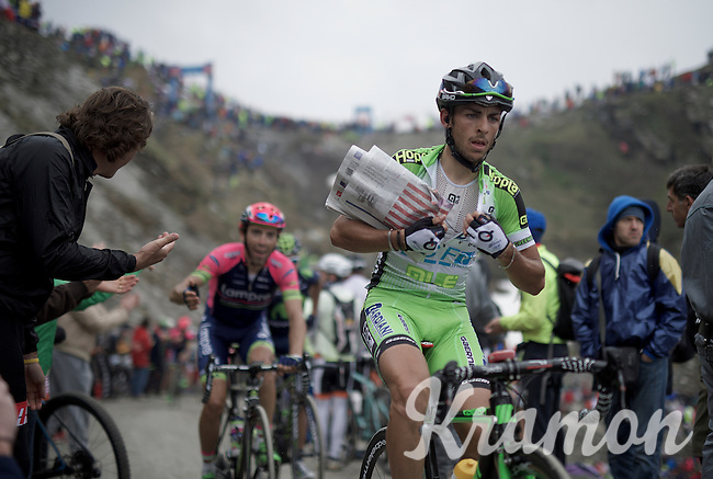 "stuffing a ""gazetta"" under his jersey (against the cold down the descent) up the dirt roads of the Colle delle Finestre (2178m)<br /> <br /> Giro d'Italia 2015<br /> stage 20: Saint Vincent - Sestriere (199km)"