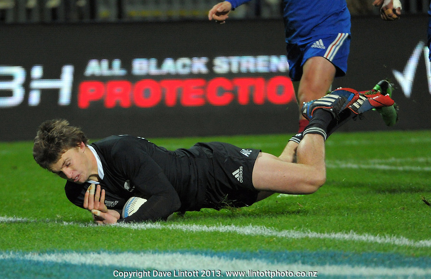 Beauden Barrett scores for the All Blacks during the international rugby match between the New Zealand All Blacks and France at Yarrow Stadium, New Plymouth, New Zealand on Saturday, 21 June 2013. Photo: Dave Lintott / lintottphoto.co.nz