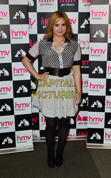 Demi Lovato.Meets fans at HMV Oxford Circus, London, England..May 28th, 2013.full length white black pattern top skirt dress tights hand on hip.CAP/BF.©Bob Fidgeon/Capital Pictures