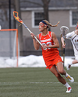 Syracuse University defender Becca Block (33) brings the ball forward.   Syracuse University (orange) defeated Boston College (white), 17-12, on the Newton Campus Lacrosse Field at Boston College, on March 27, 2013.