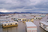 Flood disaster as caravans in a holiday caravan park float in flood water at Towyn in North Wales in 1990, UK