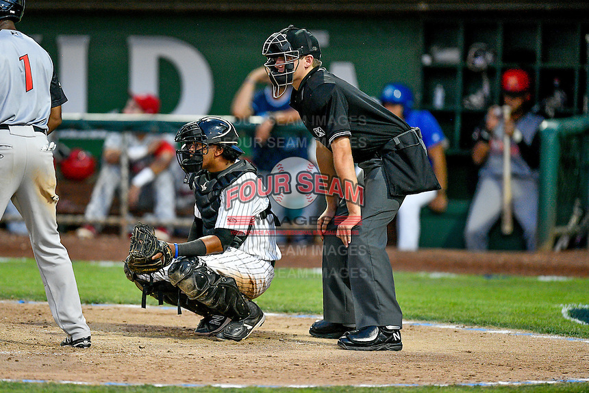 Pioneer League All-Star Meibrys Viloria (4) of the Idaho Falls Chukars and Home plate umpire Trevor Danneger during the game against the Northwest League All-Stars at the 2nd Annual Northwest League-Pioneer League All-Star Game at Lindquist Field on August 2, 2016 in Ogden, Utah.The Northwest League defeated the Pioneer League 11-5.  (Stephen Smith/Four Seam Images)