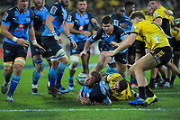 Bulls Duane Vermeulen tries to beat the tackle of Hurricanes' TJ Perenara as he charges for the line during the Super Rugby quarterfinal between the Hurricanes and Bulls at Westpac Stadium in Wellington, New Zealand on Saturday, 22 June 2019. Photo: Dave Lintott / lintottphoto.co.nz