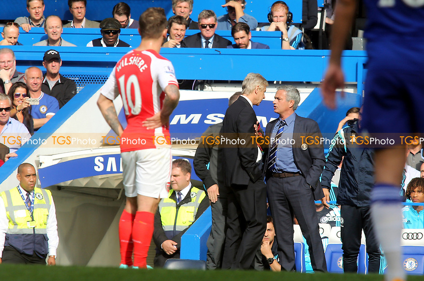 Arsenal Manager, Arsene Wenger, confronts Chelsea Manager, Jose Mourinho - Chelsea vs Arsenal - Barclays Premier League Football at Stamford Bridge, London - 05/10/14 - MANDATORY CREDIT: Paul Dennis/TGSPHOTO - Self billing applies where appropriate - contact@tgsphoto.co.uk - NO UNPAID USE