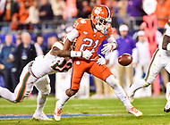 Charlotte, NC - DEC 2, 2017: Miami Hurricanes defensive back Sheldrick Redwine (22) strips Clemson Tigers wide receiver Ray-Ray McCloud (21) of the football during ACC Championship game between Miami and Clemson at Bank of America Stadium Charlotte, North Carolina. (Photo by Phil Peters/Media Images International)