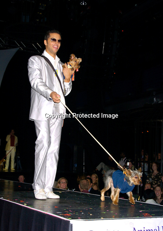 "Jai Rodriguez and his dogs Nemo and Dory ..at Animal Fair's fifth Annual "" Paws for Style"" fashion show to celebrate the 100th year anniversary of the Humane society of New York. The event was on May 24, 2004 at ..Club Black...Photo by Robin Platzer, Twin Images"