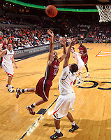 Nov 6, 2010; Charlottesville, VA, USA; Roanoke College g Melvin Felix (12) shoots the ball over Virginia Cavaliers g Jontel Evans (1) Saturday afternoon in exhibition action at John Paul Jones Arena. The Virginia men's basketball team recorded an 82-50 victory over Roanoke College.