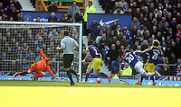 Pictured: Leighton Baines of Everton (20) closely marked by Jose Canas of Swansea (R) takes a shot, goalkeeper Gerhard Tremmel (L) dives. Sunday 16 February 2014<br />