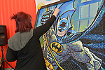 Manhattan, New York City, New York, USA. October 10, 2015. KRISTEN CUMINGS, from BelAire California, is creating a large picture of Batman using thousands of Jelly Belly Jelly Beans. The artist has worked on her creation for about 80 hours and hopes to finish it by the next day, at the 10th Annual New York Comic Con. NYCC 2015 is expected to be the biggest one ever, with over 160,000 attending during the 4 day ReedPOP event, from October 8 through Oct 11, at Javits Center in Manhattan