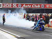 Nov 12, 2017; Pomona, CA, USA; NHRA pro stock motorcycle rider Matt Smith does a burnout during the Auto Club Finals at Auto Club Raceway at Pomona. Mandatory Credit: Mark J. Rebilas-USA TODAY Sports