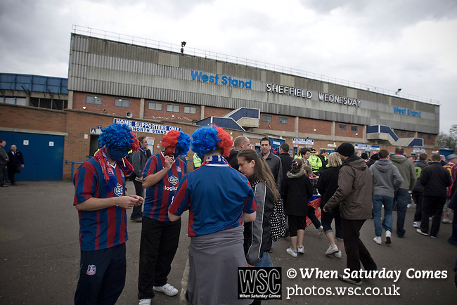 Three Crystal Palace fans wearing coloured wigs pictured outside Hillsborough before their team's crucial last-day relegation match against Sheffield Wednesday. The match ended in a 2-2 draw which meant Wednesday were relegated to League 1. Crystal Palace remained in the Championship despite having been deducted 10 points for entering administration during the season.
