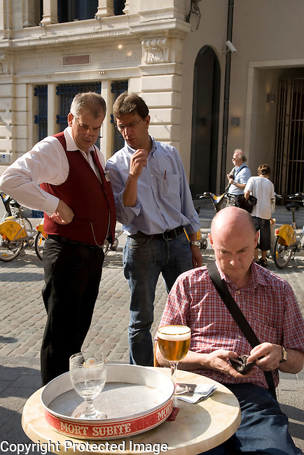 Waiter and customers on the Terrace of A la Mort Subite Cafe Bar, Brussels; Belgium; Europe