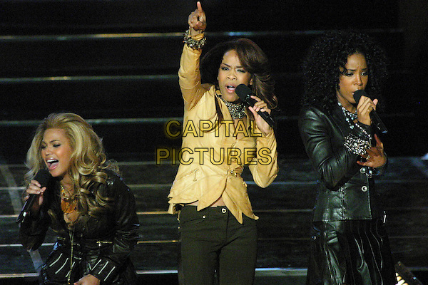 DESTINY'S CHILD.BEYONCE KNOWLES, MICHELLE WILLIAMS & KELLY ROWLAND.Perform in concert on TV programme Good Morning America's concert series, at Roseland Ballroom in New York City, USA, November 16th 2004 ..half length music on stage gig yellow gold shirt jacket pointing arm up in the air mouth open dancing singing.Ref: IW.www.capitalpictures.com.sales@capitalpictures.com.©Capital Pictures.