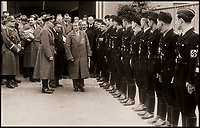 BNPS.co.uk (01202 558833)<br /> Pic: DukesAuctions/BNPS<br /> <br /> Edward, with Nazi party officials leaving the factory.<br /> <br /> Remarkable photos of Edward VIII touring a car factory during his controversial visit to Nazi Germany in 1937 have been unearthed.<br /> <br /> Huge crowds turned out to catch a glimpse of the former King, rumoured to be a strong supporter of the Nazi party and the fascist cause, who even walked through a guard of Nazi troops giving Hitler salutes.<br /> <br /> The Duke of Windsor, who had abdicated the previous year, was accompanied by high ranking Nazi party officials and even an SS officer whilst touring the Mercedes-Benz factory in Stuttgart.<br /> <br /> During the trip, the Duke had a private meeting with Hitler at his retreat in Berchtesgaden and was infamously photographed giving Nazi salutes.