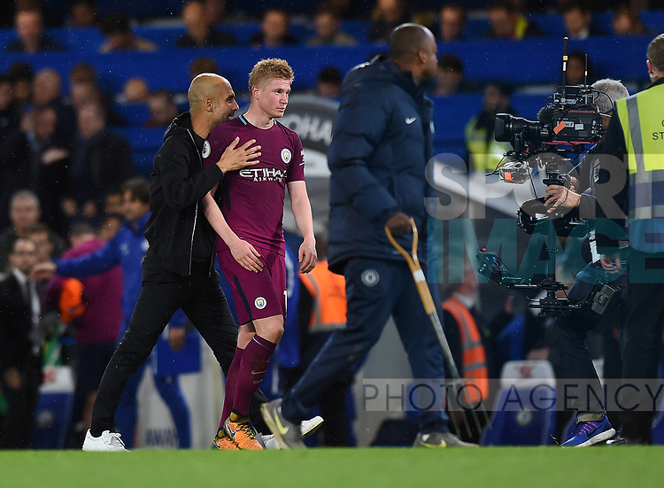 Kevin De Bruyne of Manchester City with Manchester City Manager Josep Guardiola at the end of the premier league match at the Stamford Bridge stadium, London. Picture date 30th September 2017. Picture credit should read: Robin Parker/Sportimage