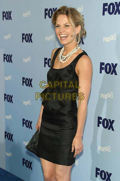 JENNIFER MORRISON.2008 Fox Televison Network Upfront (programming presentation to advertisers) at Wollman Rink in Central Park, New York, NY, USA..May 15th, 2008.half 3/4 length black dress bow necklaces clutch bag mouth open laughing .CAP/LNC/TOM.©TOM/LNC/Capital Pictures.
